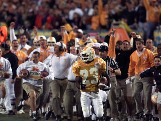 Dwayne Goodrich (23) runs back an interception for UT's second touchdown in the Fiesta Bowl against Florida State on Jan. 4, 1999.