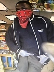One of two suspects in an armed robbery is pictured
