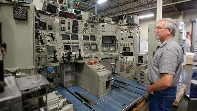 John Schaleger, a Puget Sound Naval Shipyard employee, looks at the console of the Naval Research Vessel 1 at the Keyport Undersea Museum on Tuesday. PSNS officially turned the control room of the decommissioned vessel over to the museum this week. It will be housed in the museum's archives.
