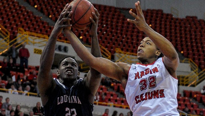 UL Ragin' Cajuns forward Bryce Washington (32) fights for a rebound Nov. 14 against Louisiana College.