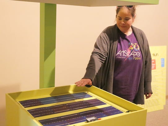 Collections Manager Lizz Ricci demonstrates how a display