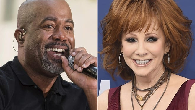"This combination photo shows Darius Rucker performing on NBC's ""Today"" show in New York on May 25, 2018, left, and Reba McEntire  at the 54th annual Academy of Country Music Awards in Las Vegas on April 7, 2019. McEntire and Rucker are promising laughs and good music when they co-host this year's CMA Awards in November. McEntire is a veteran of awards show hosting, while Rucker will be a first-time host when the show airs on Nov. 11 on ABC from Nashville, Tenn."