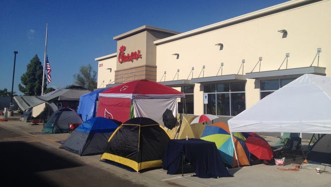 A tent city has sprung up outside a Chick-fil-A restaurant that will open at 3111 W. Peoria Avenue in Phoenix Thursday morning.