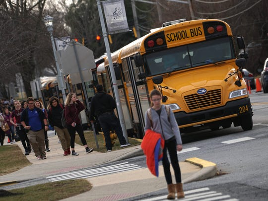 School buses load up students after school at Cab Callow School of the Arts.