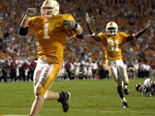 Tennessee tight end Jason Witten  (1) scores the game-winning touchdown on a 25-yard pass reception in the sixth overtime period to defeat Arkansas 41-38 on Saturday, Oct. 5, 2002 in Knoxville, Tenn. Tennessee wide receiver Tony Brown (81) is at right.