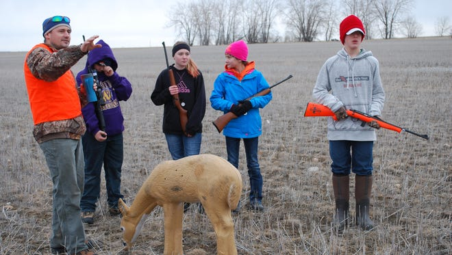 Hunter education instructor Tim Zabrocki directs students during a hunter education course in Glasgow.
