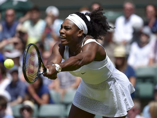 Serena Williams of U.S.A. plays a shot during her match against Margarita Gasparyan of Russia at the Wimbledon Tennis Championships in London