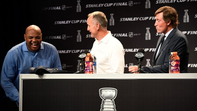 Former NBA star Charles Barkley, former Edmonton Oilers star Paul Coffey and hockey great Wayne Gretzky laugh during a press conference to announce the selection of the 1984-85 Edmonton Oilers by fans as the Greatest NHL Team of all time, before Game 4 of the Stanley Cup Final on Monday, June 5, 2017.