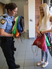 National American Miss Contestant Brindee Heaton delivers her Wee Care kits to the St. George Police Station Wednesday, June 7, 2017.