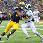 Oct 17, 2015; Ann Arbor, MI, USA; Michigan Wolverines wide receiver Jehu Chesson (86) is defended by Michigan State Spartans defensive back Demetrious Cox (7) during the 2nd half of a game at Michigan Stadium.