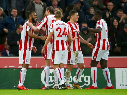 Stoke City's Eric Maxim Choupo-Moting celebrates scoring his side's second goal of the game with team mates during the English Premier League soccer match at the Bet365 Stadium, in Stoke, England, Saturday, Dec. 23, 2017. (Dave Thompson/PA via AP)