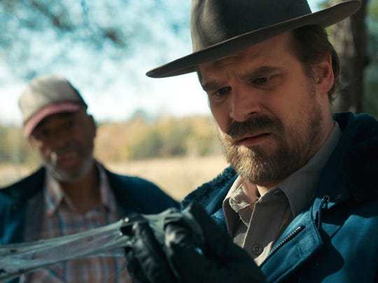 "This image released by Netflix shows David Harbour in a scene from ""Stranger Things."""