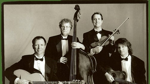 The Faux Frenchmen, a gypsy-jazz group, left to right: Guitarist Brian Lovely, bassist Don Aren, violinist Paul Patterson, and guitarist George Cunningham.
