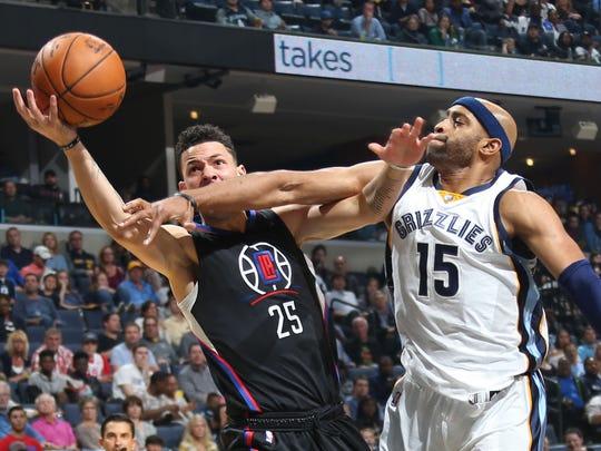 Memphis Grizzlies Vince Carter (right) fouls Los Angeles Clippers J.J. Redick (left) at FedExForum.