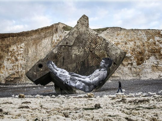 """An old, World War II bunker, which tumbled off a cliff on the coast of France, became an art canvas in """"Faces Places."""""""