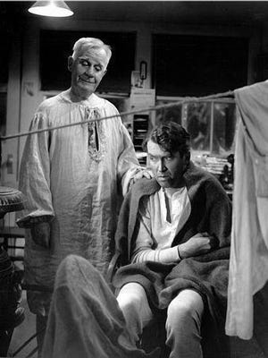 Henry Travers (left) as Clarence and James Stewart as George Bailey from the 1946 film IT'S A WONDERFUL LIFE.  Credit: RKO Radio Pictures.