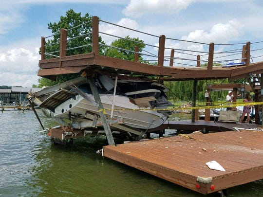 Boaters who crashed into this private dock on Sunday told wildlife officials they were returning from a night of recreation.