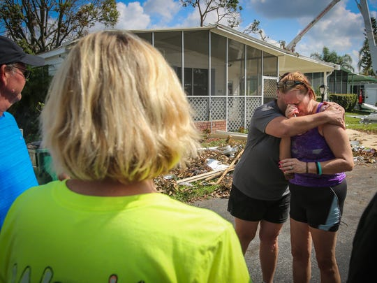 "Lisa Nagel, 52, comforts Donna Gomes, 57, outside Gomes' home in Landmark Naples, a mobile home community for seniors in North Naples Thursday, Sept. 14, 2017. Nagel helped organize a group of 12 people to drive to Naples from Minnesota to provide relief from destruction caused by Hurricane Irma. ""This is unbelievable,"" Gomes said of Nagel's efforts. ""This is a miracle."""