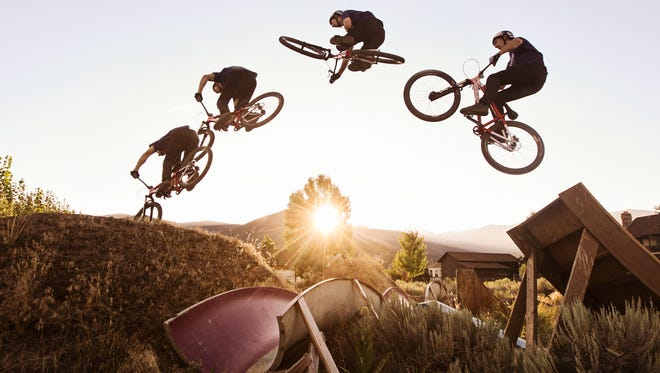 """A photo composite shows the sequence of Eric Porter performing a table top off ofa jump in the backyard of his home in Heber, Utah at sunset. """"I'd be doing what I love for work one way or another,"""" Porter said. """"I talk to kids and people all over and say that if you're in to something, you can make it your job."""" July 31, 2015"""