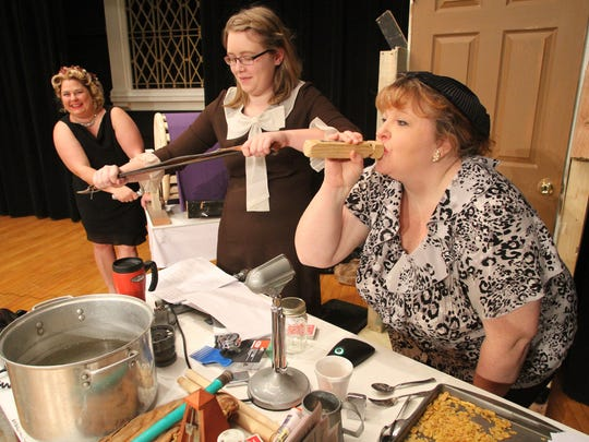 The ethusiastic ladies of the sound effects crew amp up the audio during a radio broadcast on the Hartland Players version  of It's a Wonderful Life. From left: Sasha Klavon, Jessica Kessler and MaryJo Bell.
