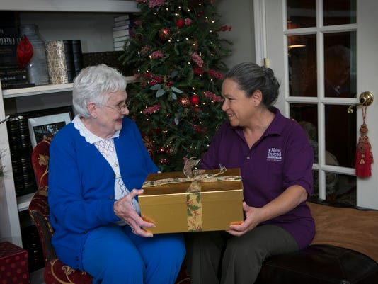 1206-ynsl-Caregiver-Senior-with-Gift.jpg