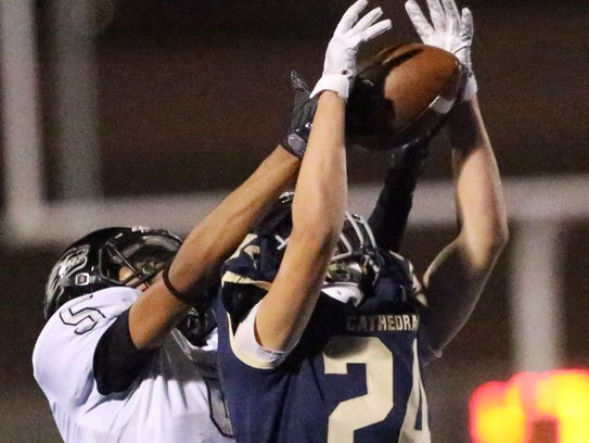 Cathedral's Victor Guzman, 24, picks off a pass intended