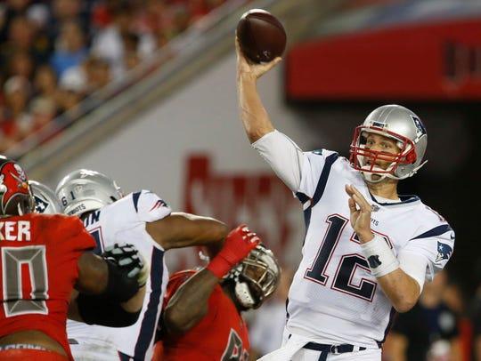 Quarterback Tom Brady throws a pass during the second