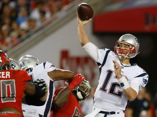Quarterback Tom Brady throws a pass during the second half of the Patriots' victory over the Buccaneers on Saturday night.
