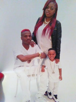 Ronnie Foxx, left, was killed May 9 in a shooting in Nashville. Foxx is pictured here in this family photo with his girlfriend, Keyara Braden, and his 3-year-old son, R.J.