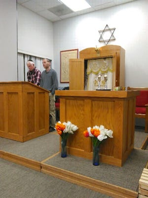 Curt Mize and his son, Lawrence Mize, attend a Friday evening Shabbat service at Fort Campbell.