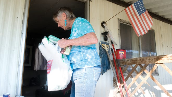 Donna Johnson delivers drinking water, plastic silverware, paper plates, and a low-flow toilet to a home without water in East Porterville. For her efforts to help those suffering during the drought, she will be honored by the American Red Cross March 20 in Fresno.