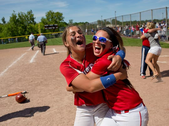 St. Clair seniors Avary Humes and Chelsea Schweiger celebrated winning a Division 2 softball regional Saturday, June 6, 2015 at Armada High School.