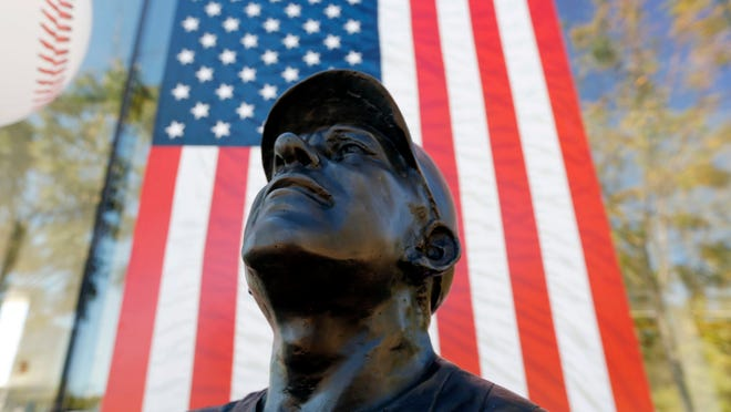 A statue of former New York Yankees hall of fame catcher Yogi Berra is seen outside of the Yogi Berra Museum, Wednesday, Sept. 23, 2015, in Little Falls, N.J. Berra died Tuesday at the age of 90. (AP Photo/Julio Cortez)