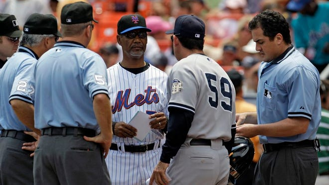 New York Mets manager Jerry Manuel exchanges lineup cards with New York Yankees bench coach Rob Thompson #59 before their interleague baseball game at Shea Stadium in New York, Sunday, June 29, 2008.