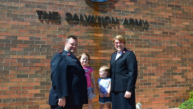 Salvation Army Shawnee Capts. Stacy and Patrick Connelly stand with their daughters Madison and Katherine outside the Shawnee Salvation Army building, at 200 E. 9th St.