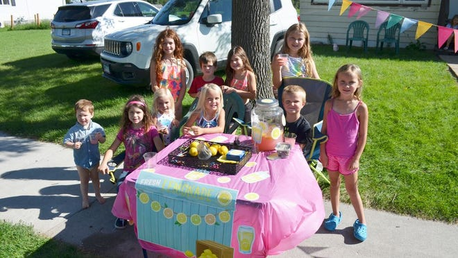 """Set up Tuesday and shown here was """"Live Laugh Lemonade"""" on Woodland Avenue with hosts Easton and Makenna, and their friends and family."""