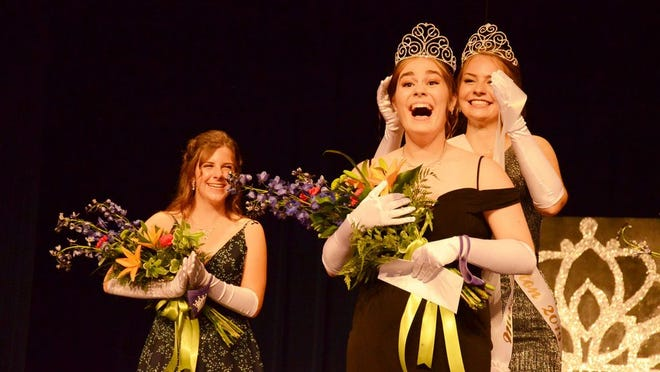 Victoria Proulx is crowned Miss Crookston 2020 by 2019 Miss Crookston Sophia Steiner. Contestant and talent winner Emily Funk looks on.
