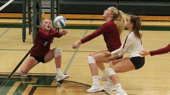Freshman Jalynn Swanson goes for a dig in a game against No. 3 Thompson on Sept. 10 at Thompson High School. The Cardinals fell to the Tommies, 3-2.