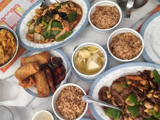 Peking Chinese Restaurant's menu is large with plates