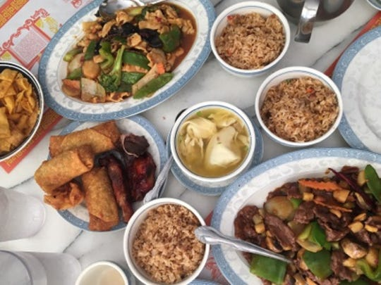 Peking Chinese Restaurant's menu is large with plates designated by protein type (veggie, fowl, pork, beef and seafood) and house specialties.