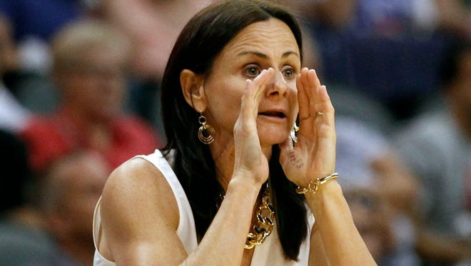 Mercury coach Sandy Brondello yells to her team during a game against the New York Liberty at US Airways Center in Phoenix on July 26, 2014.