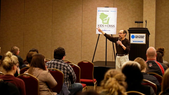 Dave Schoepke, who lost his son, Andy, to suicide, talks with audience members as part of the Kids in Crisis program last April at the Radisson Paper Valley Hotel in Appleton.