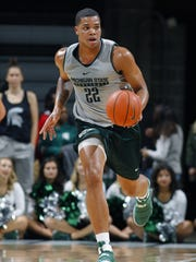 Michigan State Spartans freshman Miles Bridges pushes the ball on a fastbreak Friday, Oct. 14, 2016, in East Lansing.
