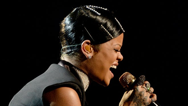 Singer Rihanna performs onstage during the 2013 American Music Awards at Nokia Theatre L.A. Live on Nov. 24, 2013, in Los Angeles.