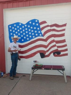 Galen Rankin, was commissioned by Minneola leadership, to repaint the picture of the American Flag that has been on the front door of the fire station for 20 years SUBMITTED PHOTO