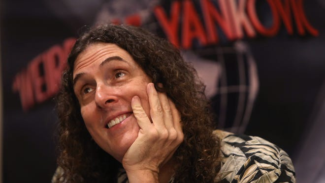 'Weird Al' Yankovic charms a fan as he signed autographs during the annual Chiller Theater Toy, Model, and Film Expo and the Parsippany Sheraton.  April 23, 2016 Parsippany, N.J.