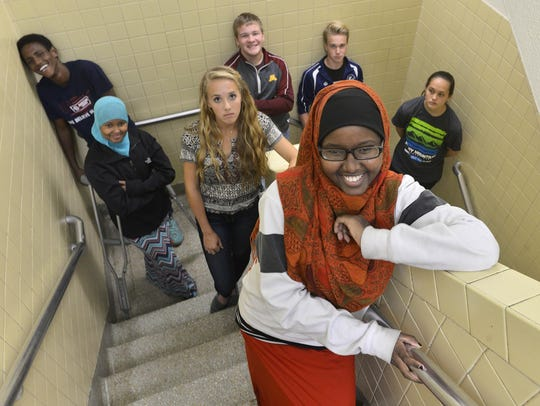 St. Cloud Tech students Rukiyo Hussein, front, and