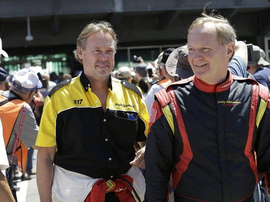 Mark Dismore,left, and teammate Scott Hackenson,right, during the driver introductions before the Indy Legends Charity Vintage Pro/Am race  at the SVRA Brickyard Vintage Racing Invitational Saturday, June 18, 2016, at the Indianapolis Motor Speedway.