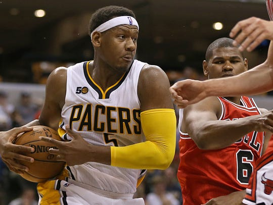Indiana Pacers forward Lavoy Allen (5) rebounds under