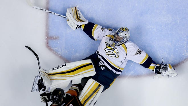 Predators goalie Pekka Rinne, right, blocks a shot by Ducks center Ryan Kesler during the third period of Game 5 on Saturday.